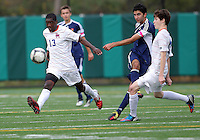 HYATTSVILLE, MD - OCTOBER 26, 2012:  Arion Sobers-Assue (13) and Thomas Madden (19) of DeMatha Catholic High School try to stop a pass from Arjan Ganji (10) of St. Albans during a match at Heurich Field in Hyattsville, MD. on October 26. DeMatha won 2-0.