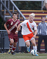 Syracuse University forward Emil Ekblom (14) drives for the net as Boston College defender Chris Ager (2) watches.Boston College (maroon) defeated Syracuse University (white/orange), 3-2, at Newton Campus Field, on October 8, 2013.