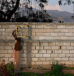 Outside a wall of the Pechinat tent camp in Jacmel. The 7.0 earthquake that devastated parts of Haiti on January 12 killed hundreds of thousands of people. January's earthquake killed hundreds of thousands of people and caused significant and lasting structural and economic damage in the Caribbean nation.