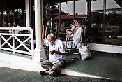 Family members wait outside the Narayana Hrudayalaya in Bangalore, Karnataka, India. Photo: Sanjit Das/Panos