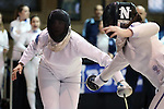 12 February 2017: UNC's Samantha Galina (left) is hit by Northwestern's Katie Van Riper (right) in Epee. The University of North Carolina Tar Heels played the Northwestern University Wildcats at Card Gym in Durham, North Carolina in a 2017 College Women's Fencing match. UNC won the dual match 15-12 overall, 5-4 Foil, 5-4 Epee, and 5-4 Saber.
