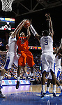 Allen Payne gets blocked going up for a shot by Josh Harrellson and Terrence Jones in the second half of UK's win over the Auburn Tigers at Rupp Arena on Jan. 11, 2011. Photo by Britney McIntosh | Staff