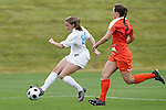 05 November 2008: North Carolina's Courtney Jones (84) passes the ball in front of Miami's Ashlee Burt (2). The University of North Carolina defeated the University of Miami 1-0 at Koka Booth Stadium at WakeMed Soccer Park in Cary, NC in a women's ACC tournament quarterfinal game.