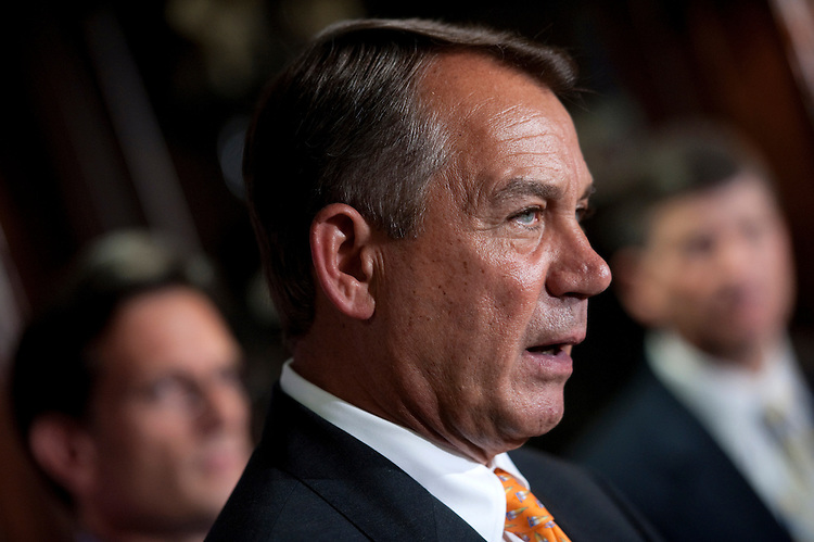 """UNITED STATES - AUGUST 1: House Speaker John Boehner, R-Ohio, speaks to the press after the Republican Conference meeting. Boehner attacking President Obama's handling of the economy, and for  """"trying to raise taxes on small businesses."""" (Photo By Chris Maddaloni/CQ Roll Call)"""