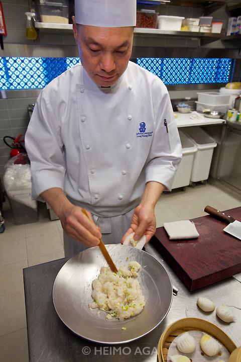 China, Hong Kong S.A.R..The Ritz-Carlton, Hong Kong. World's highest Dim Sum at Tin Lung Heen. Making of: Golden shrimp dumplings with bamboo shoots and asparagus.