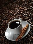 White cup of coffee on coffe beans background