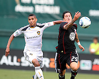 Santino Quaranta #25 of D.C. United tangles with Sean Franklin #28 of the Los Angeles Galaxy during an MLS match at RFK Stadium on July 18 2010, in Washington D.C. Galaxy won 2-1.