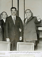 "Moscow?, March 24, 1973..Saddam Hussein with Soviet president Leonid Brejnev..Photograph recovered by Bruno Stevens in the looted ""Triumphant Leader"" museum in Baghdad, entirely dedicated to the glory of Saddam Hussein."
