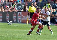 02 June 2013: U.S. National Women's Team player Tobin Heath #17 battles with Canadian Women's player Rhian Wilkinson #7during an international friendly soccer match between the U.S Women's National Team and the Canadian Women's National Team at BMO Field in Toronto, Ontario Canada.