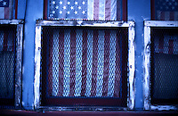 North America, United States of America, California, San Francisco, American flag in apartment window, ©Stephen Blake Farrington