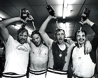 Oakland A's celebrate after winning the World Series.against the  Reds in  1972. L-R Mike Epstein, Dave Duncan, Joe Rudi, and Sal Bando. (photo copyright 1972 Ron Riesterer)