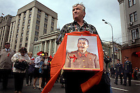 Communist supporters, carrying red flags and portraits of Lenin and Stalin, pour out on the street in Moscow on Labour Day to demonstrate. © Justin Jin
