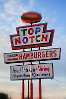 The Top Notch Hamburgers Neon Vintage Sign on Burnet Road stands to remind of a long-gone era when hamburger joints were social gathering destinations for the masses of americana.