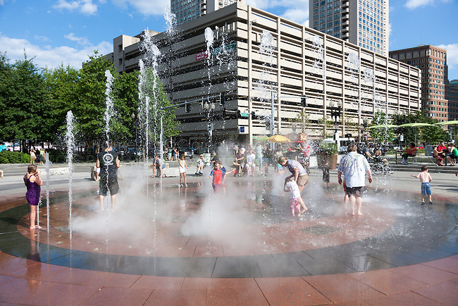 Families and kids enjoy the fountain in the Rose F. Kennedy Greenway in Boston, Massachusetts