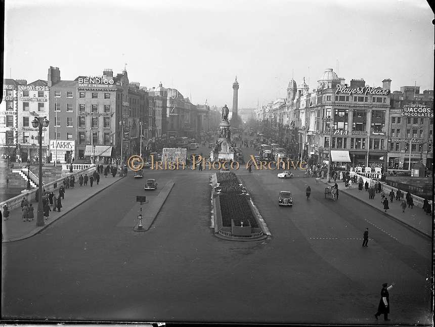 Views of O' Connell Bridge, O' Connell Street, Dublin. 07/01/58,<br /> View of O'Connell Street, Dublin (Irish Baile Atha Cliath), capital and largest city of the Republic of Ireland (Eire, Ireland) at the east coast and the mouth of the river Liffey at Dublin Bay. O'Connell Monument, the memorial to Daniel O&rsquo;Connell, 19th century nationalist leader, by sculptor John Henry Foley which stands at the entrance to the street named after him.The Nelson Pillar known locally as Nelson's Pillar or simply The Pillar, was a large granite pillar topped by a statue of Horatio Nelson in the middle of O'Connell Street (formerly Sackville Street) in Dublin. It was built in 1808-1809 and was destroyed by a bomb planted by Irish Republicans in 1966. Old pictures  of The Nelson Pillar, O' Connell Bridge, O' Connell Street, Dublin, Ireland.<br /> Old picture of The Nelson Pillar, O' Connell Bridge, O' Connell Street, Dublin, Ireland.<br /> Old photos of The Nelson Pillar, O' Connell Bridge, O' Connell Street, Dublin, Ireland.<br /> The Nelson Pillar, O' Connell Bridge, O' Connell Street, Dublin, Ireland.<br /> Irish old photo of The Nelson Pillar, O' Connell Bridge, O' Connell Street, Dublin, Ireland.<br /> Irish old picture of The Nelson Pillar, O' Connell Bridge, O' Connell Street, Dublin, Ireland.<br /> Irish black and white photos of The Nelson Pillar, O' Connell Bridge, O' Connell Street, Dublin, Ireland.<br /> black and white photos of The Nelson Pillar, O' Connell Bridge, O' Connell Street, Dublin, Ireland.<br /> Irish  historic of The Nelson Pillar, O' Connell Bridge, O' Connell Street, Dublin, Ireland.<br /> Irish old photographs of The Nelson Pillar, O' Connell Bridge, O' Connell Street, Dublin, Ireland.<br /> <br /> Irish vintage photos   of  The Nelson Pillar, O' Connell Bridge, O' Connell Street, Dublin, Ireland.<br /> Irish historic photos  of  The Nelson Pillar, O' Connell Bridge, O' Connell Street, Dublin, Ireland.