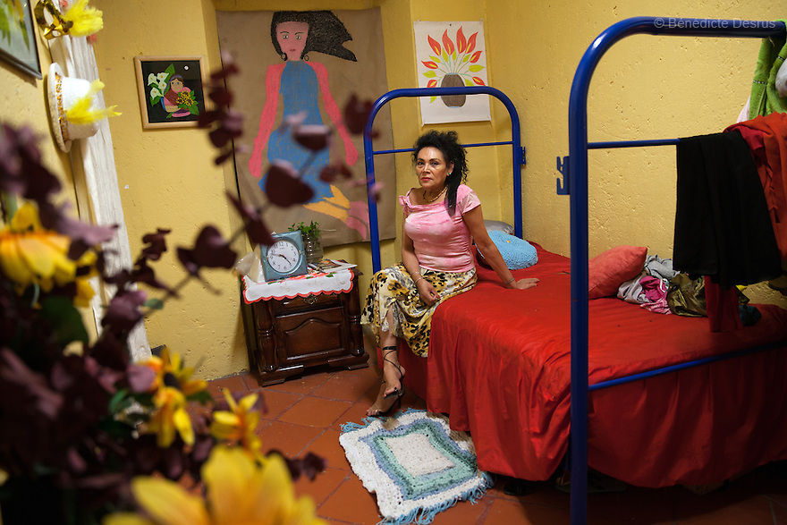 Norma Angelica, a resident of Casa Xochiquetzal, in her bedroom in Mexico City, Mexico on May 27, 2014. Casa Xochiquetzal is a shelter for elderly sex workers in Mexico City. It gives the women refuge, food, health services and a space to learn about their human rights, as well as courses to help them rediscover their self-confidence and deal with traumatic aspects of their lives. Casa Xochiquetzal provides a space to age with dignity for a group of vulnerable women who are often invisible to society at large. It is the only such shelter existing in Latin America. Photo by Benedicte Desrus