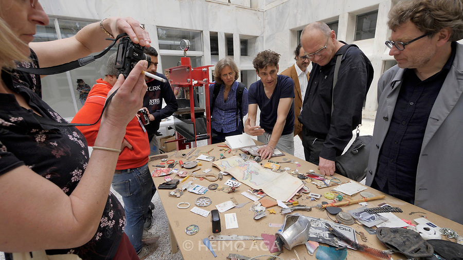 Athens, Greece. Opening days of documenta14. Athens Conservatoire (Odeion Athinon). Installation by Daniel Knorr: pressing objets trouvées from Athen's streets between book pages.