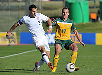 Carlos Bocanegra of USA and Richard Garcia of Australia...Football - International Friendly - USA v Australia - Ruimsig Stadium, June 5, 2010.