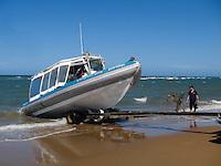 QZ2666-D. retrieving Yongala Dive's boat at Alva Beach, near Ayr. Australia, Pacific Ocean.<br /> Photo Copyright &copy; Brandon Cole. All rights reserved worldwide.  www.brandoncole.com