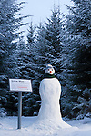Snow man beside a spoof &quot;endangered species sign&quot;