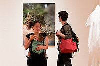 Man, woman, child and art at University of Washington Master of Fine Art Thesis exhibition. Photograph biy Robert Wade.