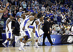 John Wall and Darius Miller run off the bench celebrating after UK's second round  win, 90-60 over Wake Forest in the NCAA tournament at New Orleans Arena on Saturday, March 20, 2010. Photo by Britney McIntosh | Staff