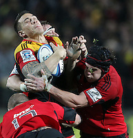 Chiefs' Sonny Bill Williams is tackled by Crusaders' Owen Franks and Matt Todd in the semi-final Super Rugby match, Waikato Stadium, Hamilton, New Zealand, Friday, July 27, 2012.  Credit:SNPA / David Rowland