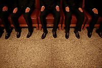 Security agents wear black as they sit on chairs inside the Great Hall of the People where sessions of the National People's Congress (NPC) and the Chinese People's Political Consultative Conference (CPPCC) are taking place, in Beijing, China March 5, 2016.   REUTERS/Damir Sagolj