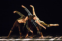 London, UK. 24.06.2016. LA Dance Project presents a mixed bill of dance from choreographers Sidi Larbi Cherkaoui and Benjamin Millepied. The piece shown is:  Harbor Me, by Sidi Larbi Cherkaoui. The dancers are: Aaron Carr, Morgan Lugo, Robbie Moore. Photograph © Jane Hobson.