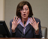 Dr. Caroline Namrow gestures as she testifies during the trial of sniper suspect John Allen Muhammad in courtroom 10 at the Virginia Beach Circuit Court in Virginia Beach, Virginia on October 27, 2003. Namrow was a customer at the gas station in Aspen Hill, Maryland where Premkumar Walekar was shot. <br /> Credit: Davis Turner - Pool via CNP
