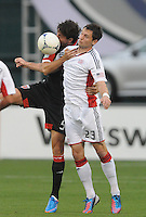 New England Revolution forward Blake Brettschneider (23) goes against D.C. United defender Dejan Jakovic (8)  D.C. United defeated The New England Revolution 3-2 at RFK Stadium, Saturday May 26, 2012.