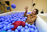 Micaela Torrero relaxes in a multi-sensory room at the Instituto de Buena Voluntad (the Good Will Institute) in Montevideo, Uruguay. Sponsored by the Methodist Church of Uruguay, the institute works with youth and adults with disabilities. It receives financial support from United Methodist Women. Outside the room, Torrero spends much of her time in a wheelchair.