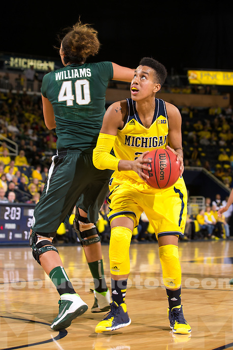 The University of Michigan women's basketball team falls to Michigan State, 79-72, at Crisler Arena in Ann Arbor, Mich. on January 12, 2014.