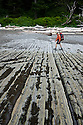 WA06829-00...WASHINGTON - Hiker along the Pacific Coast near Hole-In-The-Wall in Olympic National Park. (MR#H2)