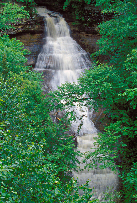 Chapel Falls is seen through the trees in spring as it spills into the Chapel Basin in Pictured Rocks National Lakeshore near Mesltrand, Michigan.