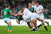 Matthew Byrne of Ireland U20 is tackled by Lewis Boyce of England U20. World Rugby U20 Championship Final between England U20 and Ireland U20 on June 25, 2016 at the AJ Bell Stadium in Manchester, England. Photo by: Patrick Khachfe / Onside Images