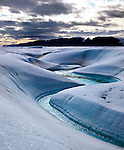 Blue Melt River, Petermann Glacier, in remote northwestern Greenland, on Nares Strait. Photographed during a 2009 Greenpeace expedition to investigate the effects of climate change in the Arctic. In 2010 and 2012 Petermann calved ice islands totalling 400 square kilometres. (c) 2009 Dave Walsh