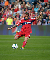 Chicago midfielder Daniel Paladini (11) shoots the ball.  The Chicago Fire defeated the New York Red Bulls 3-1 at Toyota Park in Bridgeview, IL on April 7, 2013.