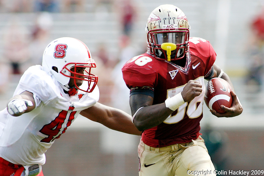 TALLAHASSEE, FL 10/31/09-FSU-NCST FB09 CH27-Florida State's Jermaine Thomas, right, tries to elude N.C. State's Dwayne Maddox during first half action Saturday at Doak Campbell Stadium in Tallahassee. .COLIN HACKLEY PHOTO