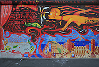 Section of the Berlin Wall depicting a detail of the painting Ode An Die Freude or Ode to Joy by Fulvio Pinna, damaged by graffiti, part of the East Side Gallery, a 1.3km long section of the Wall on Muhlenstrasse painted in 1990 on its Eastern side by 105 artists from around the world, Berlin, Germany. Picture by Manuel Cohen