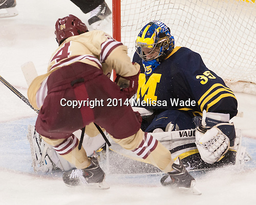 Zach Sanford (BC - 24), Zach Nagelvoort (Michigan - 35) - The Boston College Eagles defeated the visiting University of Michigan Wolverines 5-1 (EN) on Saturday, December 13, 2014, at Kelley Rink in Conte Forum in Chestnut Hill, Massachusetts.