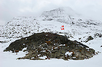 Damaged Swiss flag flying close to the Susten Pass(2259m), connecting Uri and Bern, shortly before it closed for a seven month winter.