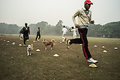 Young cricketers from the Calcutta Parsee Club attending cricket training sessions at the Maidan in Kolkata, West Bengal, India.