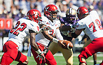 Eastern Washington Eagles' quarterback Vernon Adams Jr. (3) hands off to running back Quincy Forte (22) at Husky Stadium September 6, 2014 in Seattle. Huskies out lasted the Eagles in a high powered shootout 59-52 in the third highest scoring game in Husky history. Adams passed for 475 yards, 7  touchdowns and rushed for 43 yards.  ©2014. Jim Bryant  Photo. All Rights Reserved