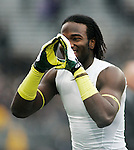 An Oregon player flashes a O sign before a college football game against Washington at Husky Stadium in Seattle, Washington on October 12, 2013. The Oregon Ducks beat the Washington Huskies 45-24.  © 2013. Jim Bryant Photo. All Rights Reserved.