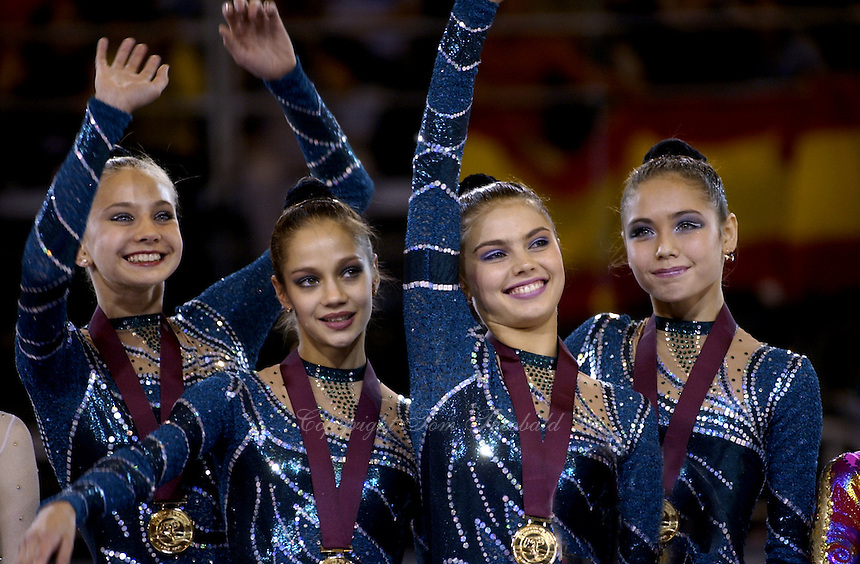 October 19, 2001; Madrid, Spain:  (L-R) Olga Belova, Irina Tchachina, Alina Kabaeva, Lyasan Utiasheva of Russia smile celebrate after winning team gold at 2001 World Championships at Madrid.