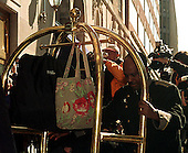 Washington, DC - January 26, 1999 -- Monica Lewinsky's luggage is carried out of the Mayflower Hotel on 26 January, 1999..Credit: Ron Sachs / CNP