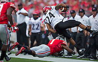 Ohio State Buckeyes cornerback Bradley Roby (1) tackles San Diego State Aztecs wide receiver Colin Lockett (24) during the second quarter of the NCAA football game at Ohio Stadium in Columbus on Sept. 7, 2013. (Alex Holt / The Columbus Dispatch)