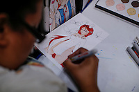 New York City, NY. 10 October 2014. People make comic drawings while they attend the 2014 New York Comic Con fair at the Jacob Javits Center. Photo by Kena Betancur/VIEWpress