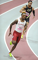 NWA Democrat-Gazette/ANDY SHUPE<br /> Arkansas sophomore Kevin Harris (1404) pulls away from Purdue sophomore Malcom Dotson while competing in the  200 meters Saturday, Feb. 11, 2017, during the Tyson Invitational in the Randal Tyson Track Center in Fayetteville. Visit nwadg.com/photos to see more photographs from the meet.